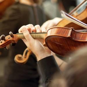 "alt=""Violin Section playing together"""